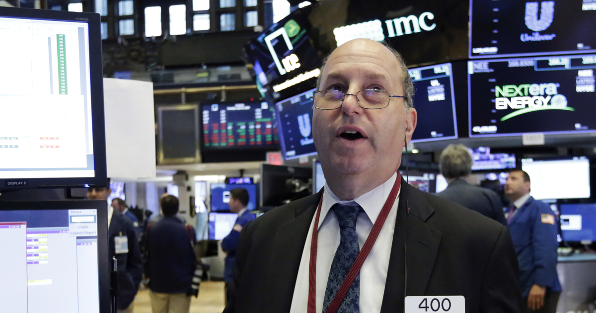 Trader Gordon Charlop works on the floor of the New York Stock Exchange, Tuesday, July 24, 2018. Stocks are opening broadly higher on Wall Street as investors were pleased to see strong earnings reports from a number of U.S. companies. (AP Photo/Richard Drew)